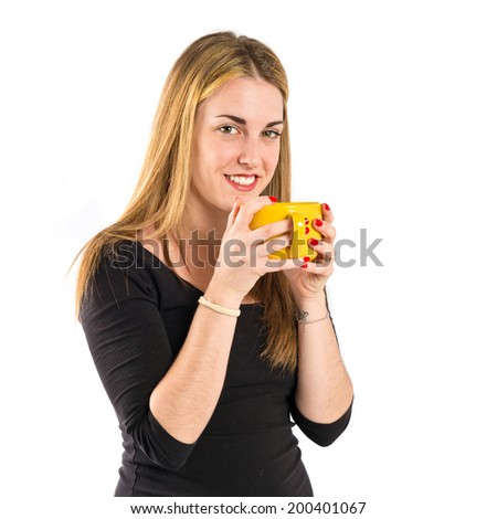 Pretty girl holding a cup of coffee over white background
