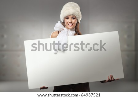 Pretty girl holding a white message board