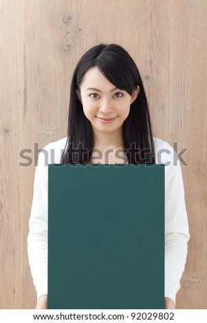 Pretty Girl Holding Chalkboard - stock photo