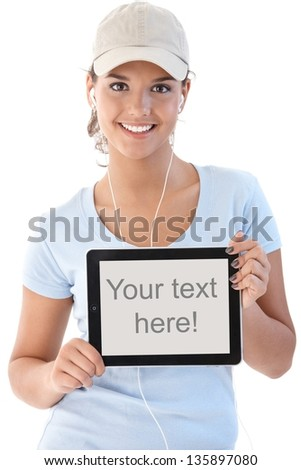 Pretty girl holding tablet with blank screen, smiling. - stock photo