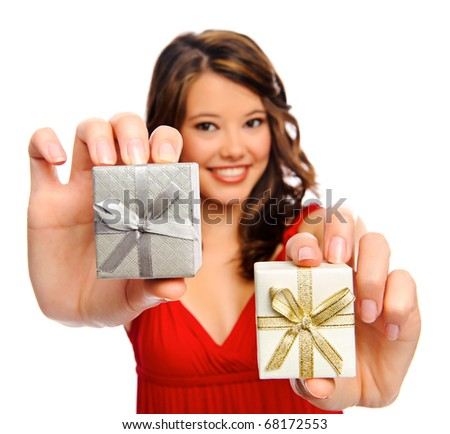 Pretty girl holds up two presents she received - stock photo