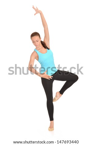 Pretty girl in a blue t-shirt doing exercise on a white background