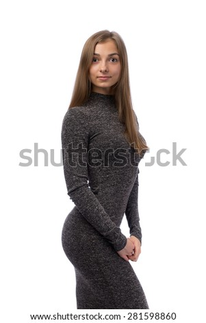 Pretty girl in a gray dress in the studio. Isolate on white. - stock photo