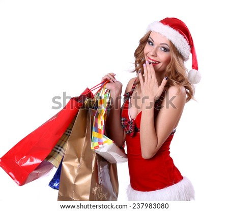 Pretty girl in a red hat with colorful bags isolated over white background. - stock photo