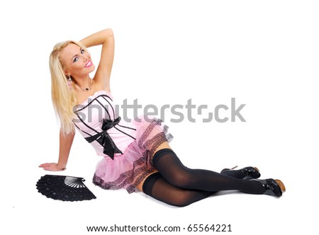 Pretty girl in a rose corset sit on the floor and keeps hand behind her head - stock photo