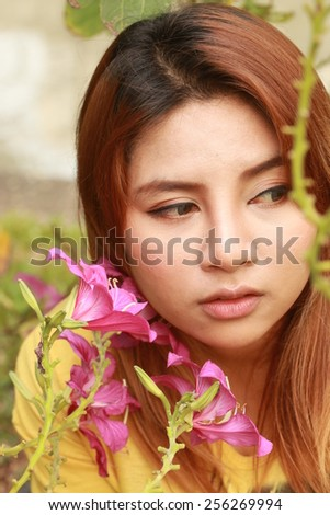Pretty girl in among of pink  flowers