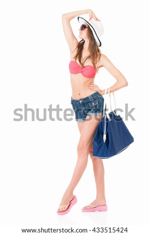 Pretty girl in bikini, summer hat and bag, isolated on white background