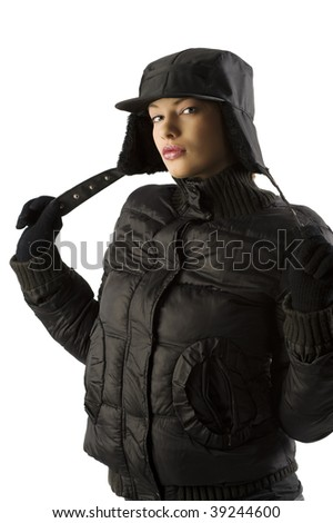 pretty girl in black windbreaker jacket and black hat looking in camera