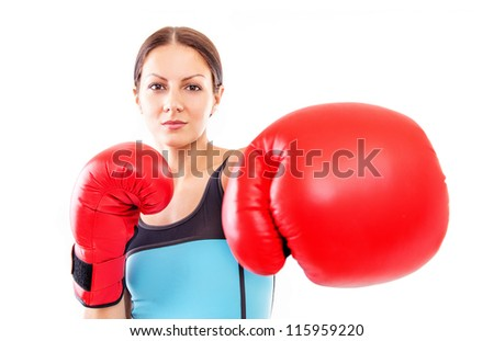 Pretty girl in boxing gloves pose, FOCUS ON FACE - stock photo