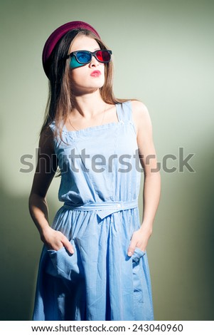 Pretty girl in 3d glasses thoughtfully looking forward - stock photo