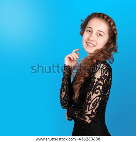 Pretty girl in fashionable stylish clothes. Attractive model dressed in black guipure dress. Young woman in a beautiful evening dress. Beautiful Brunette with Hairstyle. Beauty, fashion, style. - stock photo