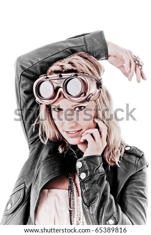 Pretty girl in leather jacket wearing steampunk goggles - stock photo