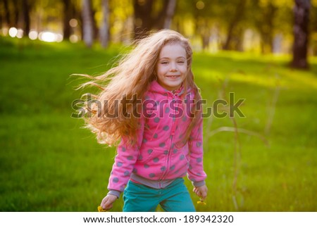 Pretty girl in park. Happy girl running in the park. Wind blows hair. Happiness, smile, summer - stock photo