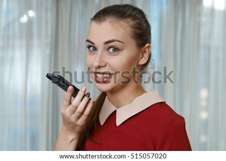 Pretty girl in red dress talking on iPhone