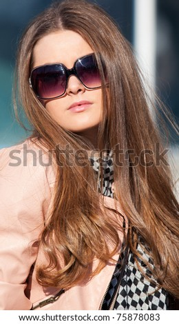 Pretty girl in sunglasses close-up - stock photo
