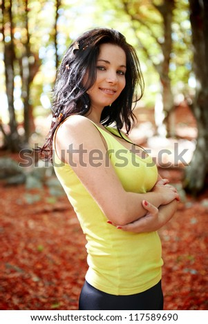 Pretty girl in the autumn forest with yellow leaves - stock photo