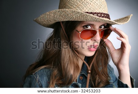 pretty girl in the cowboy hat and sunglasses
