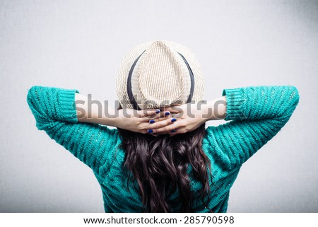Pretty girl in the hat leaned rear view - stock photo