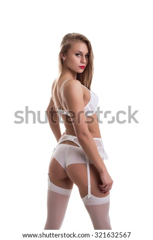 Pretty girl in underwear with belt and suspenders