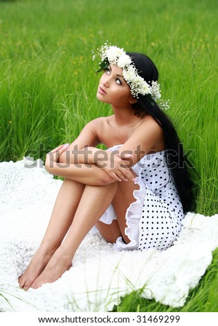 Pretty girl in white dress and diadem in nature - stock photo