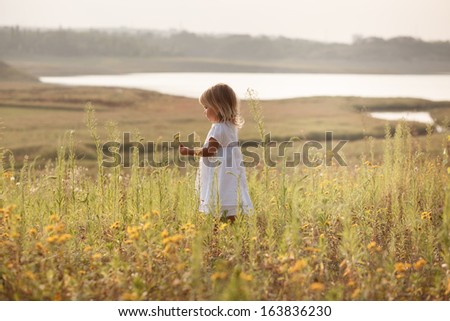 pretty girl in white dress beside the pond - stock photo
