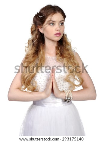 Pretty Girl in white wedding dress, made hands in prayer pose, isolated on white - stock photo