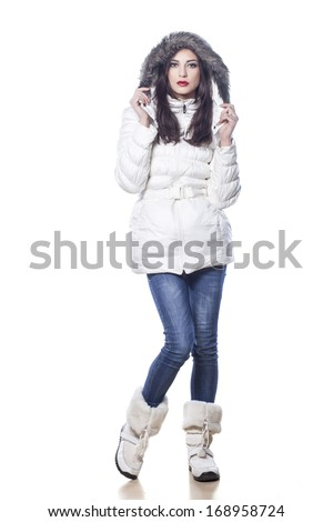 pretty girl in winter clothes posing on white background - stock photo