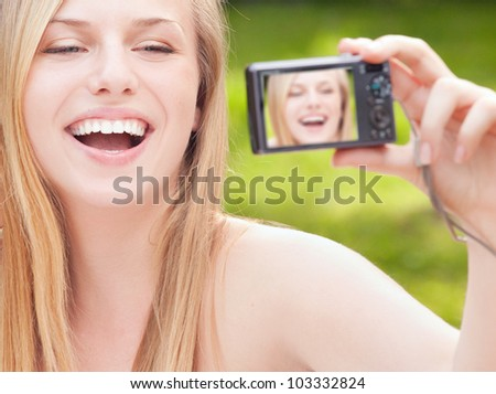 Pretty girl is taking a self portrait - stock photo