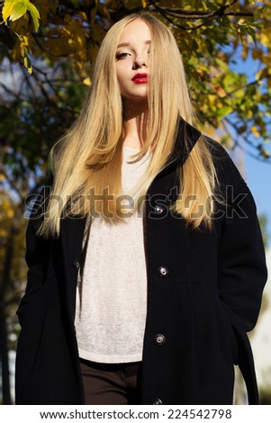 Pretty girl is wearing winter black coat - stock photo