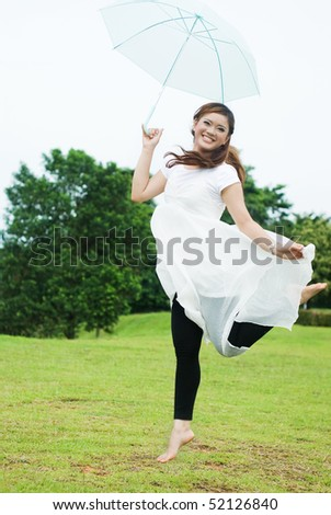 pretty girl jumping with umbrella