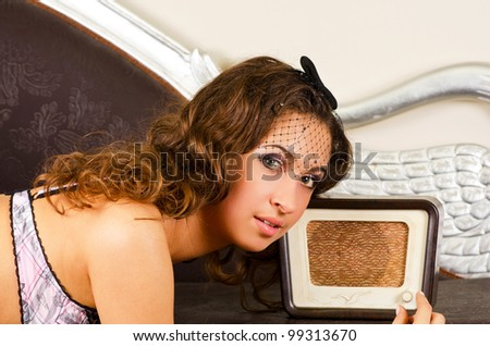 pretty girl listening music on retro radio