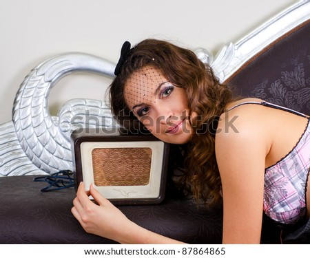 pretty girl listening music on retro radio - closeup portrat