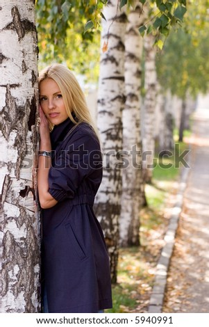 Pretty girl near  birch