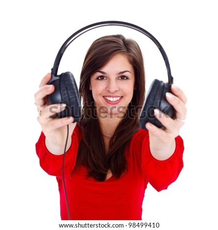 Pretty girl offering us headphones