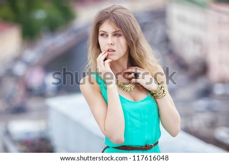 Pretty girl on a roof - stock photo