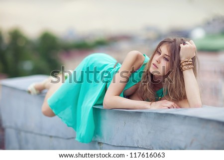 Pretty girl on a roof