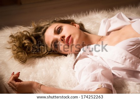 Pretty girl  on the bed in an elegant bedroom