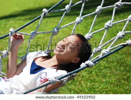pretty girl on the swing - stock photo