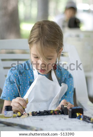 Pretty girl painting totem - stock photo