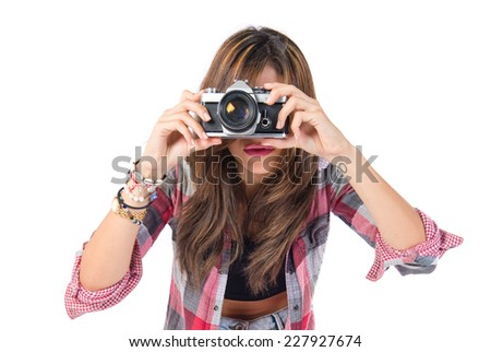 Pretty girl photographing over white background