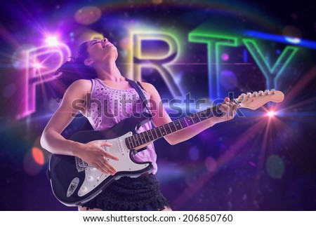 Pretty girl playing guitar against digitally generated colourful party text - stock photo