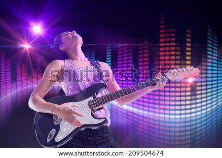 Pretty girl playing guitar against digitally generated disco light design - stock photo