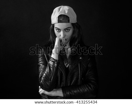 Pretty girl portrait wearing leather jacket and basket cap monochrome