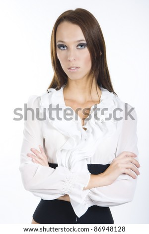 Pretty girl posing in a black and white top with ruffles - stock photo