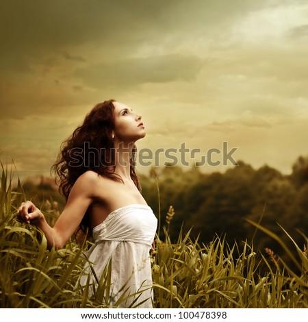 pretty girl posing outdoors - stock photo