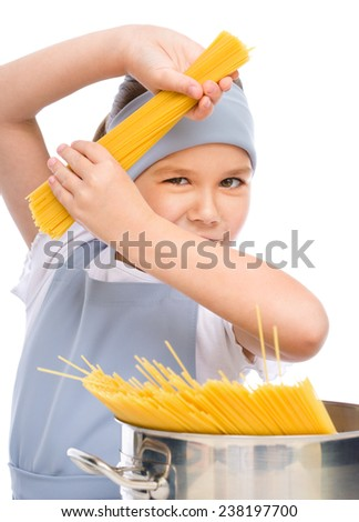 Pretty girl preparing spaghetti, isolated over white - stock photo