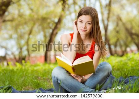 pretty girl read book in park - stock photo