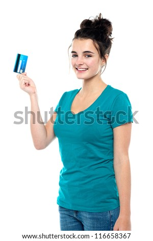 Pretty girl ready to make use of her cash card. Its shopping time!
