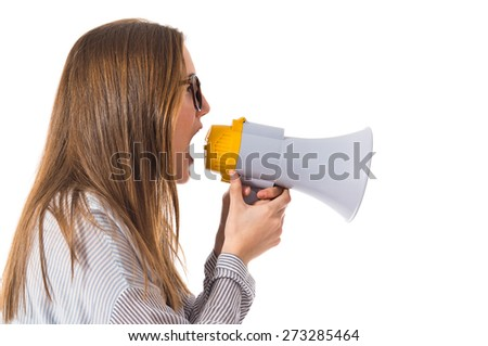 Pretty girl shouting by megaphone