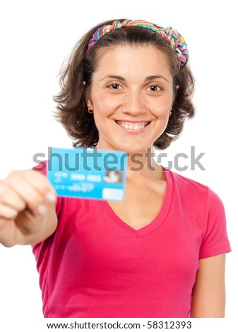 Pretty girl shows a credit card - stock photo